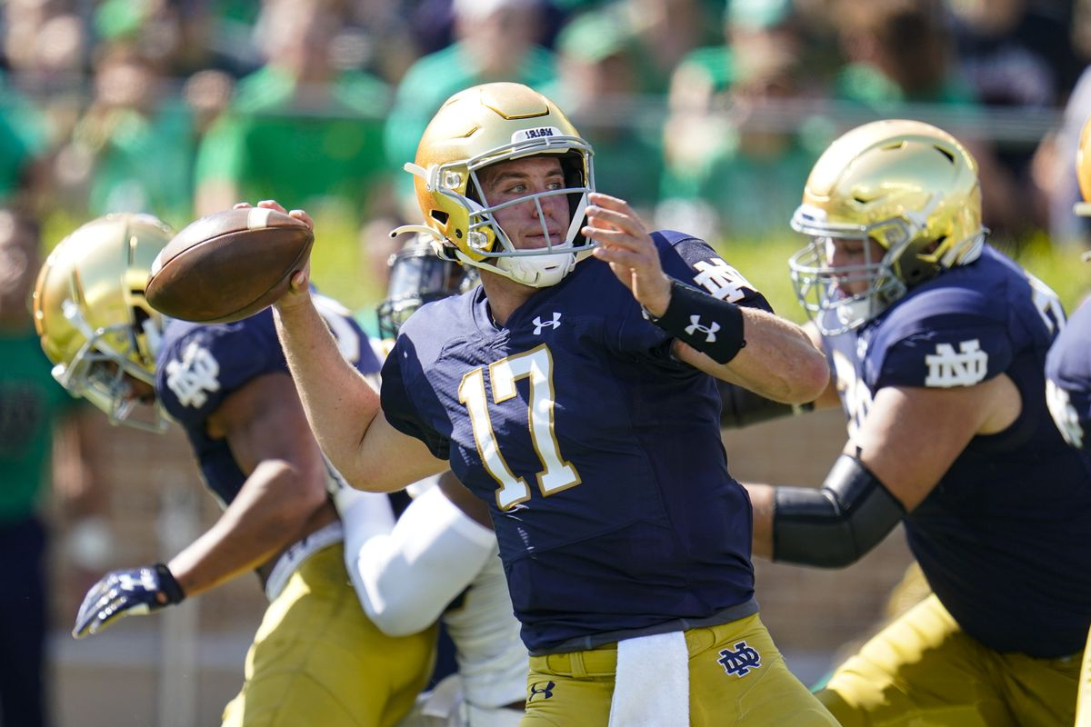 Notre Dame quarterback Jack Coan, who transferred from Wisconsin, will face his old team on Saturday.