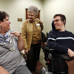 Laura Anderson, left, and Kris Fawson talk with public advocate Andrew Riggle of the Utah Disability Law Center after a House Judiciary Committee meeting at the Capitol in Salt Lake City on Wednesday, Feb. 3, 2016. They all gave their opinions concerning HB101, a bill that would eliminate the requirement that some wards be represented by an attorney in guardianship proceedings.
