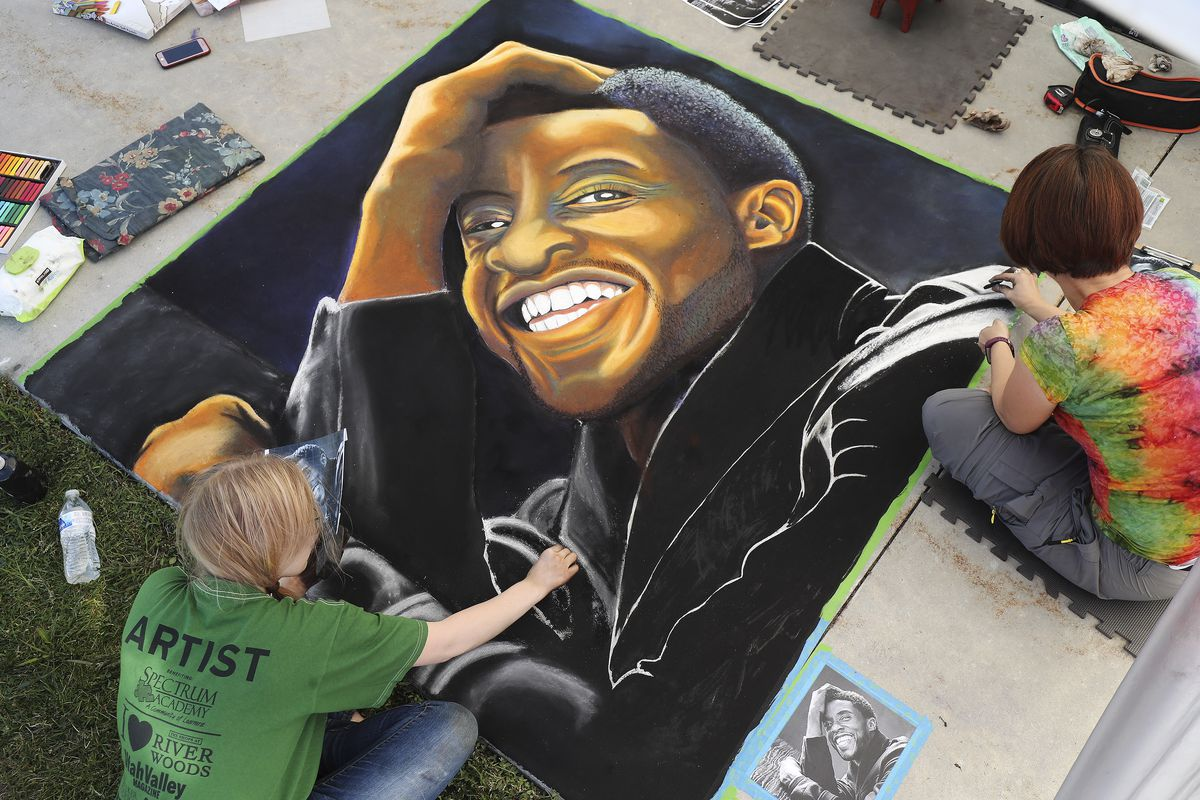 Emma Wadsworth and Sara Nybo work on their chalk art of actor Chadwick Boseman during the fourth year of Chalk the Walk in West Jordan on Saturday, Sept. 5, 2020. The Salt Lake County Library welcomed chalk artists and their fans to participate in the library's first in-person event since COVID-19 measures went into effect in March.