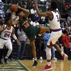 Morgan Park's Deshawndre Washington (24) tries to save the ball against Curie in heir 65-60 loss in the CPS Championship game at Chicago State University in Chicago, Sunday, February 17, 2019. | Kevin Tanaka/For the Sun Times