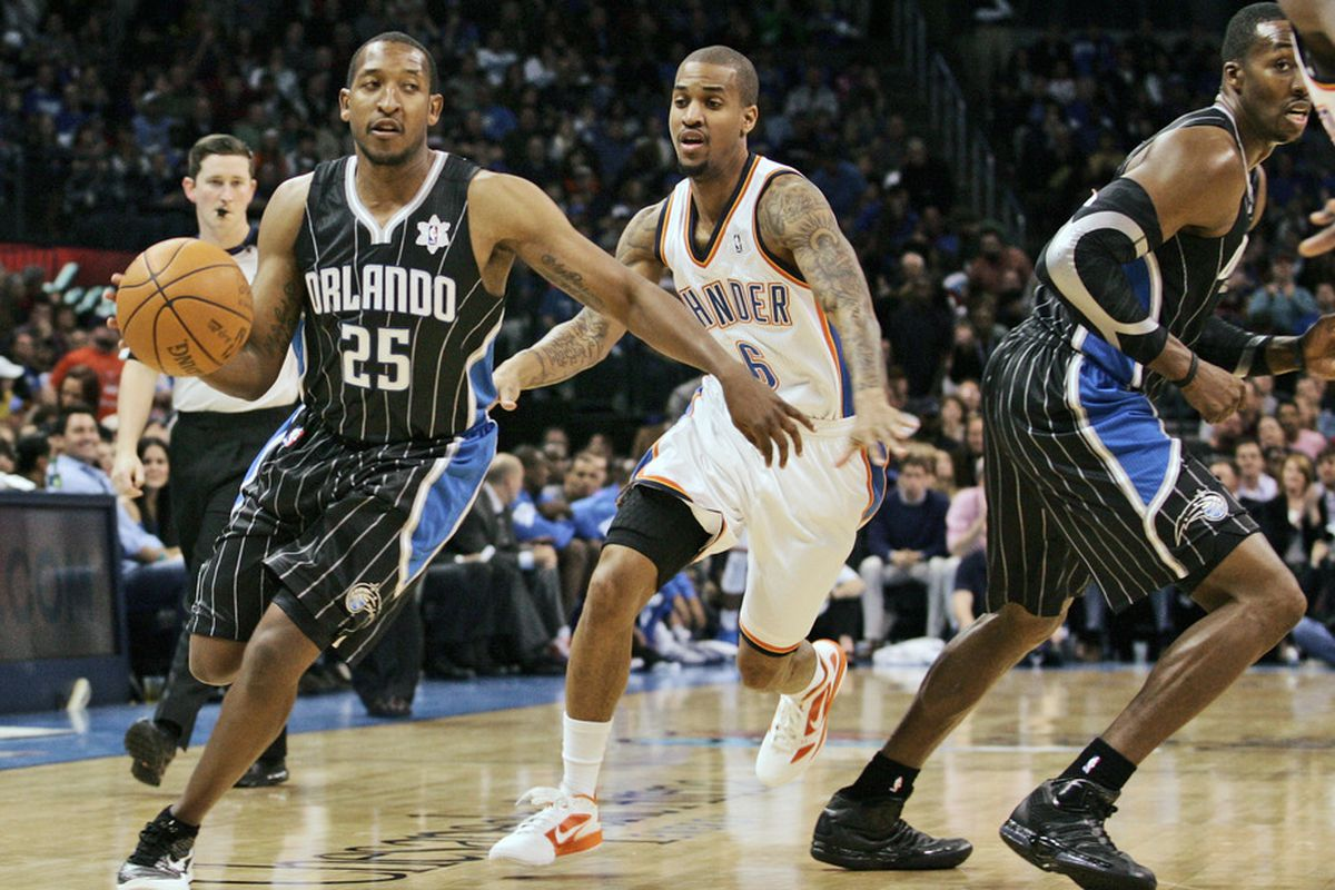 Chris Duhon, left, is pictured here with teammate Dwight Howard. Howard was one of the small pieces moved in the four-team trade that sent Duhon to the Lakers.