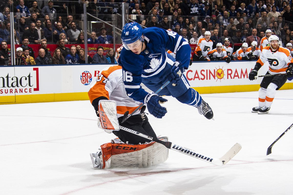 Mitch Marner #16 of the Toronto Maple Leafs flies through the air during the first period against the Philadelphia Flyers at the Scotiabank Arena on November 9, 2019 in Toronto, Ontario, Canada.