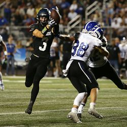 Corner Canyon's Cody Hagen catches a pass over the middle for a touchdown as Bingham's Mason Christiansen and Isaiah Glasker collide as they play a high school football game at Corner Canyon on Friday, Aug. 30, 2019. Corner Canyon won 56-28.