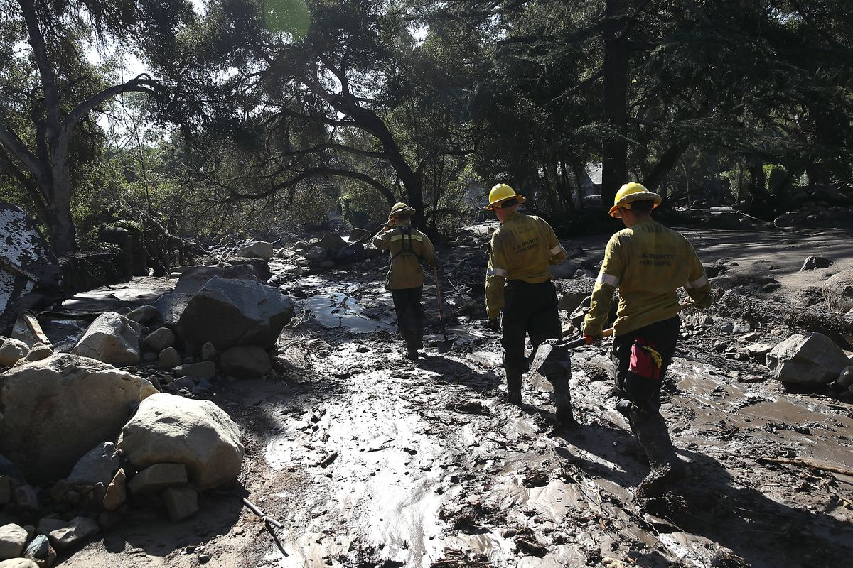Search and rescue team in a neighborhood destroyed by the mudslides in Santa Barbara County in January.