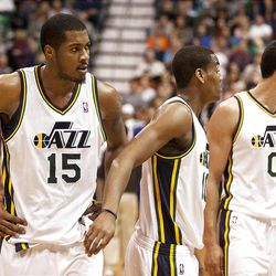 Jazz players look on after the tussle on the court during the first half of the NBA basketball game between the Utah Jazz and the Golden State Warriors at Energy Solutions Arena, Wednesday, Dec. 26, 2012.