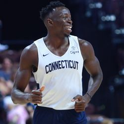 Amida Brimah is all smiles after a dunk.