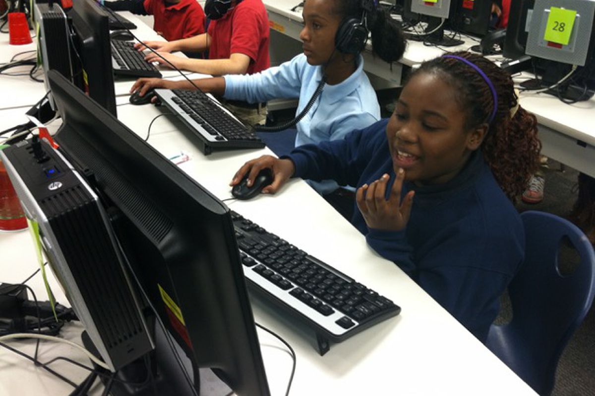 Students use computers at Key Learning Community in 2014.