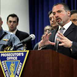 Newark Police Department Police Director Sam DeMaio talks to the media during a news conference talking about the arrest of members of a luxury car theft ring, Tuesday, April 17, 2012, in Newark, N.J. Prosecutors say the Newark-based thieves traveled to affluent communities from Bergen to Ocean counties in search of luxury vehicles. They would usually strike during the early morning and most often would grab cars that still had their keys inside. Eleven people have been arrested, most of them from Newark. Among the vehicles recovered were a Porsche, a Ferrari, a Mercedes and two BMWs.