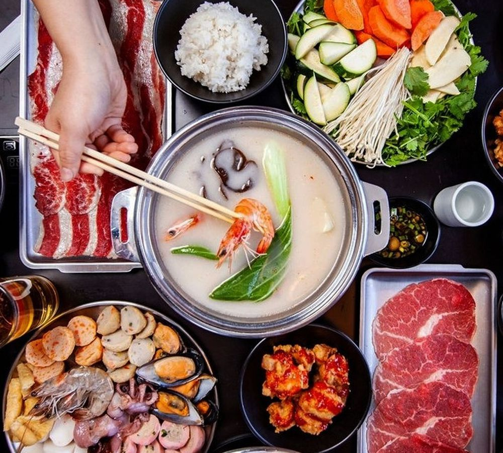 The hot pot shabu shabu dish at Shabuya, surrounded by ingredients of meats, shrimp, seafood and vegetables.
