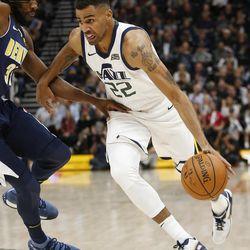 Utah Jazz forward Thabo Sefolosha (22) drives on Denver Nuggets forward Kenneth Faried (35) in Salt Lake City on Wednesday, Oct. 18, 2017. The Jazz won  106-96.