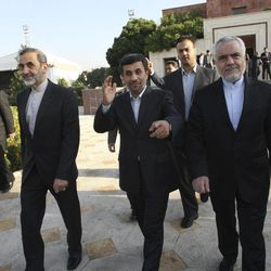 FILE- In this file Monday, Sept. 19, 2011 file photo, Iranian President Mahmoud Ahmadinejad, center, waves to media, while gesturing to the photographer, as he leaves Tehran's Mehrabad airport, Iran, for New York to attend the UN General Assembly. Vice-President Mohammad Reza Rahimi, right, and advisor to the supreme leader, Ali Akbar Velayati, left, accompany him during his official departure ceremony. As Iran's president crafts his talking points for his annual trip to New York, one message is likely to remain near the top: Tehran has not closed the door on nuclear dialogue and is ready to resume negotiations with world powers.