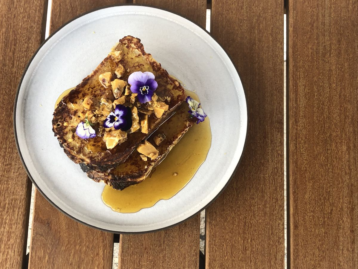 french toast with syrup and flowers
