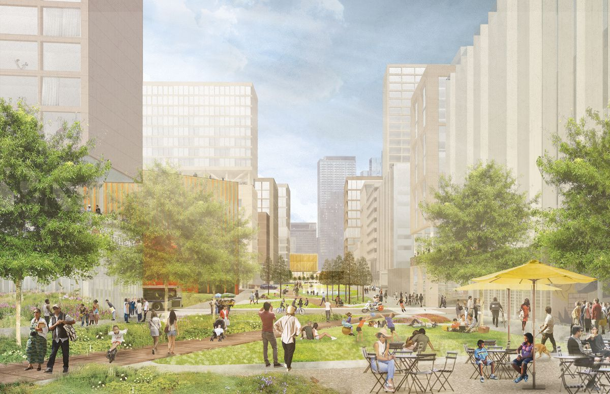 A linear park dissects two rows of mid- and high-rise buildings.