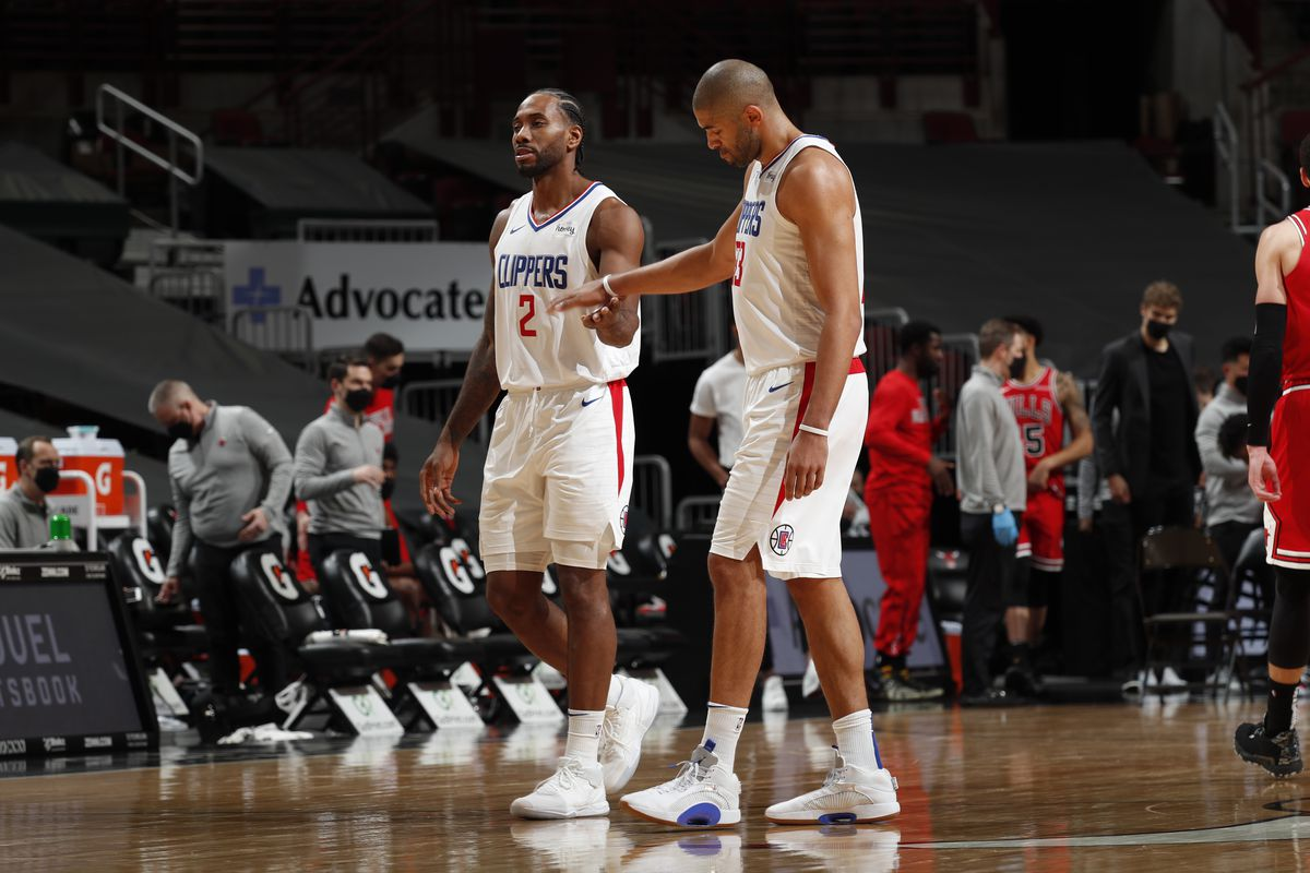 Kawhi Leonard and Nicolas Batum of the LA Clippers hi-five during the game against the Chicago Bulls on February 12, 2021 at United Center in Chicago, Illinois.