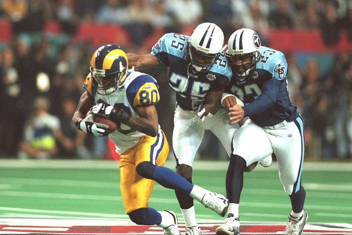 Isaac Bruce catches a pass in Super Bowl XXXIV