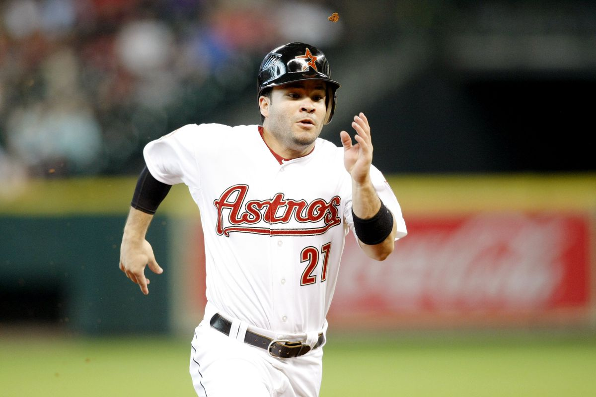 July 28, 2012; Houston, TX, USA; Houston Astros second baseman Jose Altuve (27) runs to third against the Pittsburgh Pirates in the fifth inning at Minute Maid Park. Mandatory Credit: Brett Davis-US PRESSWIRE