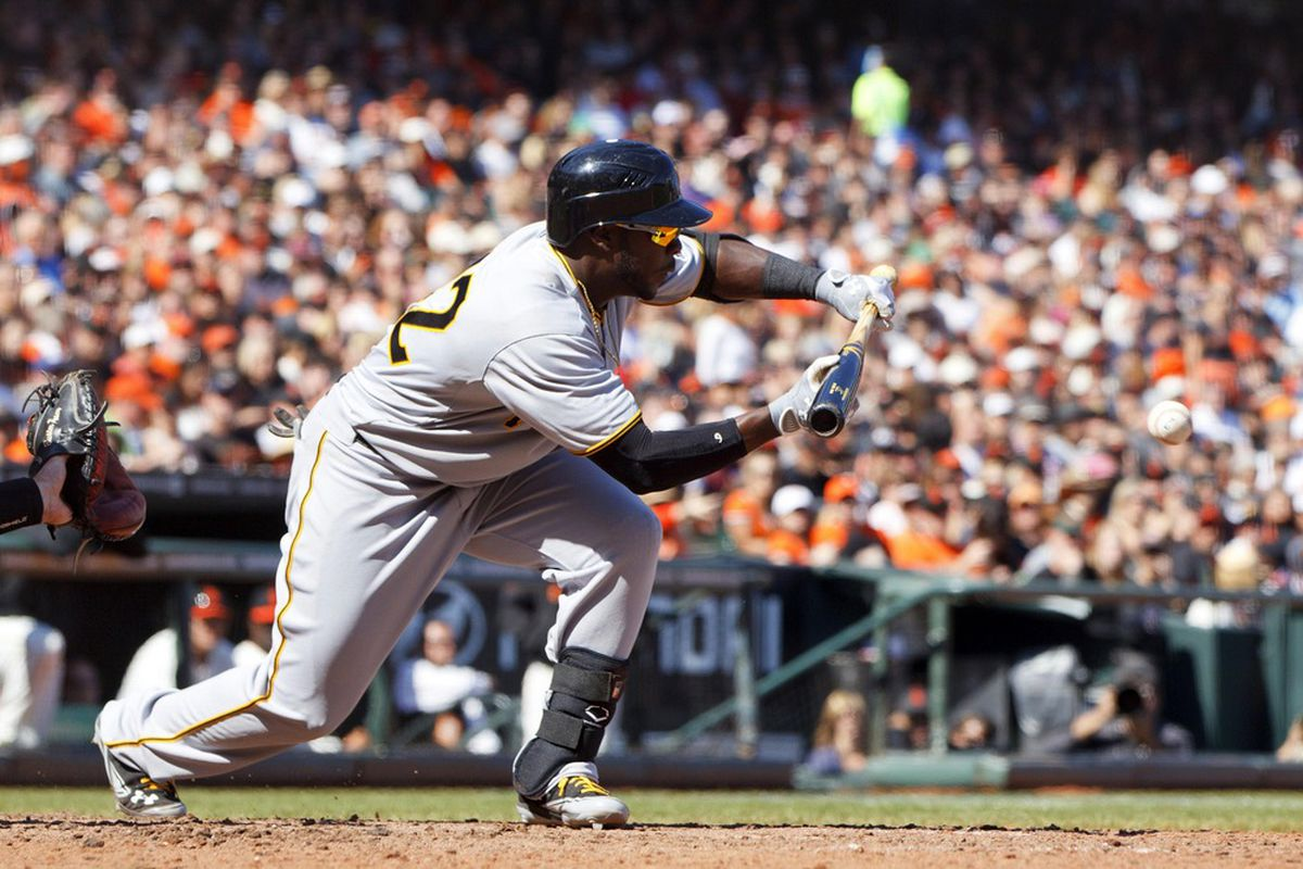 April 15, 2012; San Francisco, CA, USA; Pittsburgh Pirates third baseman Josh Harrison bunts for an RBI against the San Francisco Giants during the eighth inning at AT&T Park. Mandatory Credit: Jason O. Watson-US PRESSWIRE