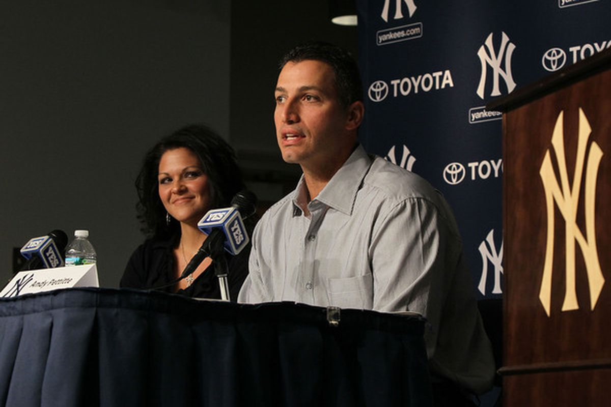 Andy Pettitte of the New York Yankees and his wife Laura Pettitte attend a press conference to announce his retirement on February 4 2011. (Photo by Jim McIsaac/Getty Images)