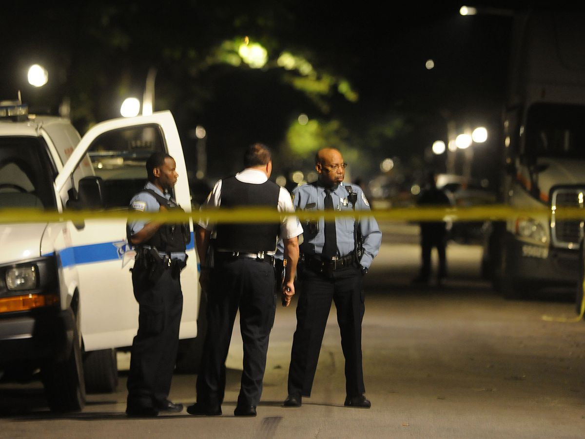 Police investigate a shooting about 2:30 a.m. Friday, August 24, 2018 in the 6200 block of South Carpenter Ave in Chicago. | Justin Jackson/ Sun-Times