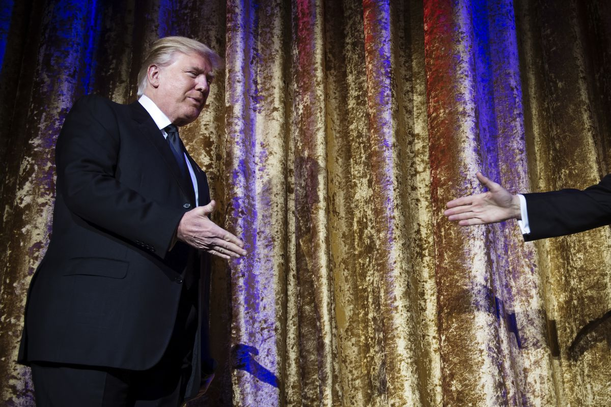 President-elect Donald Trump arrives at the Chairman's Global Dinner, an invitation-only, black-tie event which gave him an opportunity to introduce himself to foreign diplomats.