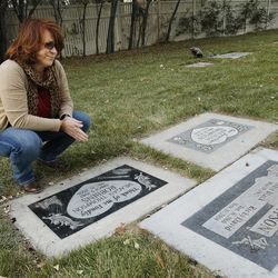 Angie Thompson visits the grave of her husband, Ricky, at the Murray Cemetery in Murray Nov 19, 2014. Several Thompson family members have died from cancer.