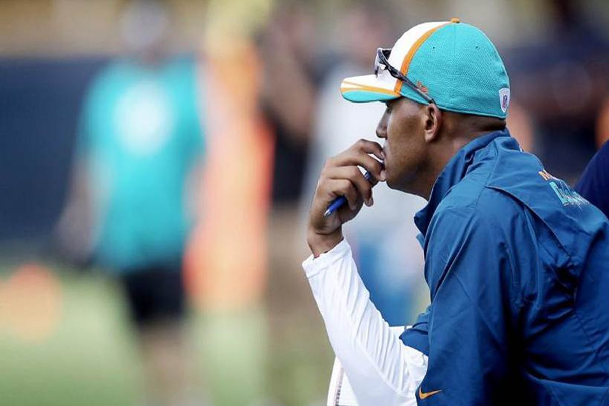 Former Miami Dolphins defensive end Jason Taylor watches the first day of the team's 2014 OTAs.
