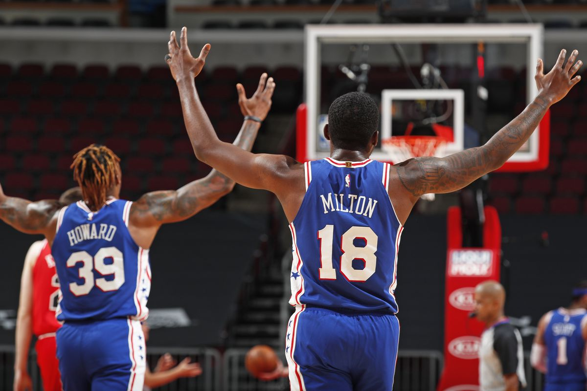 Dwight Howard #39 of the Philadelphia 76ers and Shake Milton #18 of the Philadelphia 76ers celebrate during game against the Chicago Bulls on March 11, 2021 at United Center in Chicago, Illinois.