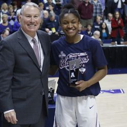 UConn's Crystal Dangerfield (5) poses with AAC commissioner Mike Aresco after being named to the All-Tournament team.