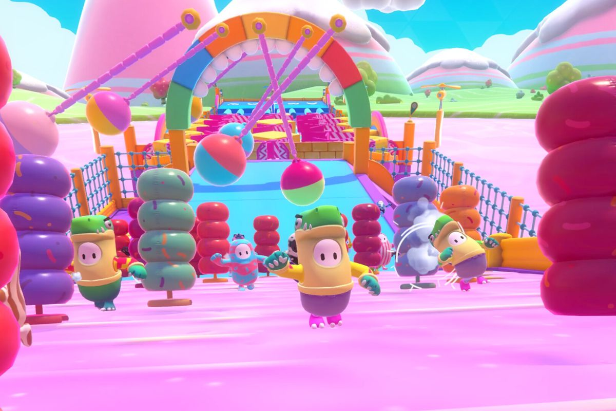 colorful, beanlike characters running en masse through an obstacle course