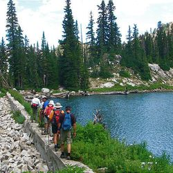 13. The hiking group nears the loop around the lake and crosses the dam.