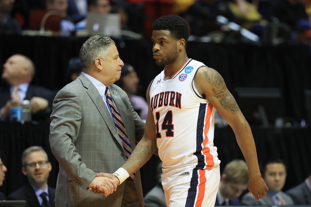 Malik Dunbar of the Auburn Tigers shakes hands with head coach Bruce Pearl of the Auburn Tigers as he leaves the court after losing in the second round of the 2018 NCAA Men's Basketball Tournament at Viejas Arena on March 18, 2018 in San Diego, California.