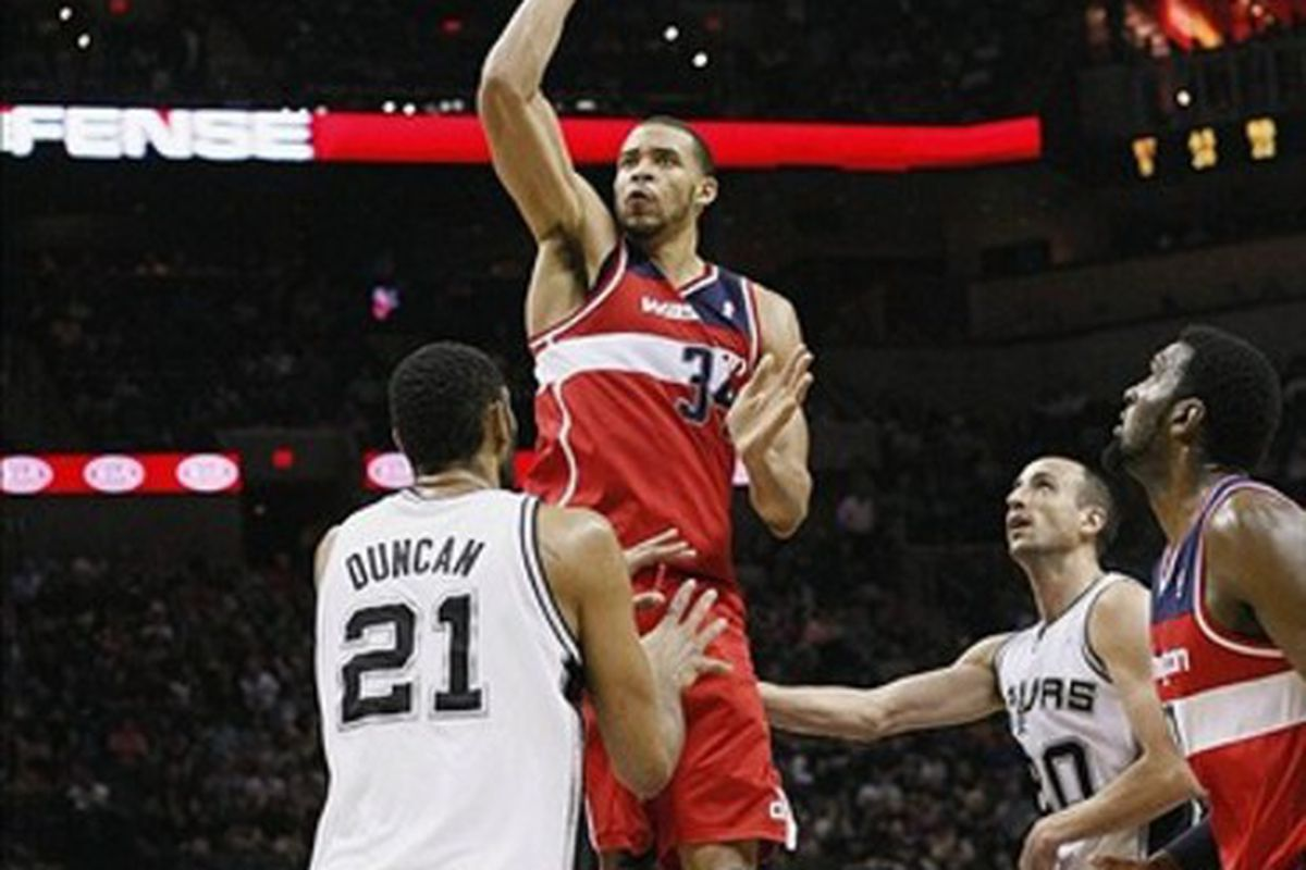 Mar 12, 2012; San Antonio, TX, USA; Washington Wizards center JaVale McGee (34) takes a shot over San Antonio Spurs forward Tim Duncan (21) during the second half at the AT&T Center. Mandatory Credit: Soobum Im-US PRESSWIRE
