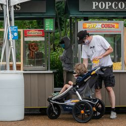 A visitor buys popcorn at Lincoln Park Zoo on the first day of Illinois' Phase 4 reopening, Friday afternoon, June 26, 2020.