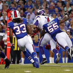Aug 16, 2013; Orchard Park, NY, USA; Buffalo Bills defensive end Jerry Hughes (55) hits Minnesota Vikings quarterback Matt Cassel (16) during the first half at Ralph Wilson Stadium. Bills beat the Vikings 20-16.