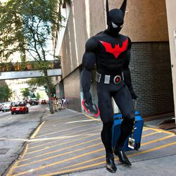 An unidentified Dragon Con attendee, dressed as Batman, walks to his hotel in downtown in Atlanta, on Friday, Aug. 31, 2012. The annual science fiction and fantasy convention drew big crowds and had more than 30,000 pre-registered attendees.