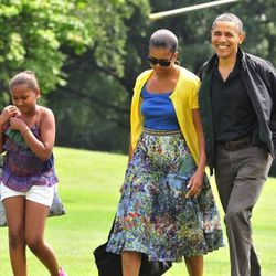 In a <b>Gregory Parkinson</b> skirt at the Obama family returns to Washington DC from Camp David on August 7, 2011