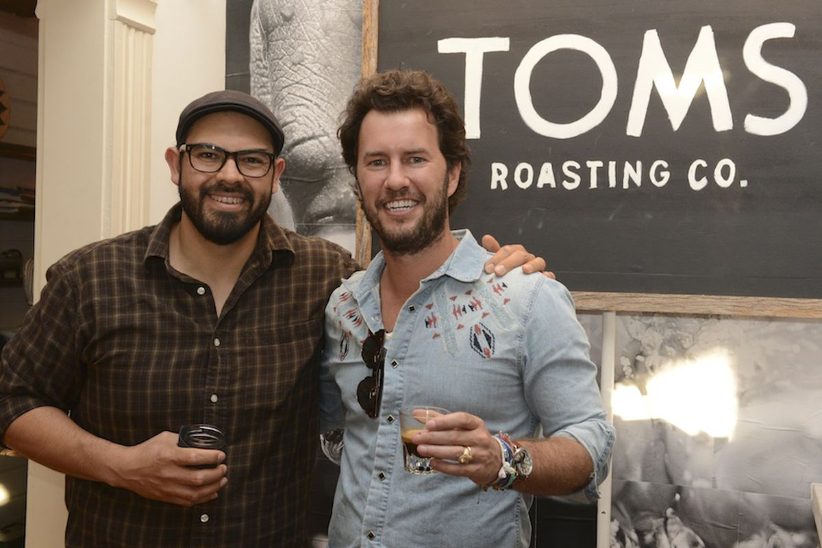 Blake Mycoskie at SXSW with his master roaster Angel Orozco, the founder of Cafecito Organico. Via Getty