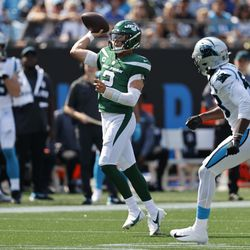 New York Jets quarterback Zach Wilson throws his first NFL touchdown pass during the second half of an NFL football game against the Carolina Panthers Sunday, Sept. 12, 2021, in Charlotte, N.C.