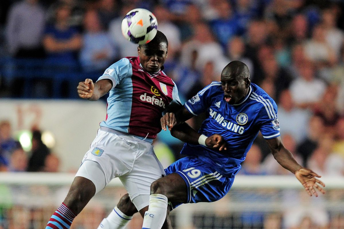 Jores Okore battles for the ball with Demba Ba on Villa's visit to Stamford Bridge in August. But if Villa sign Joleon Lescott, what does it mean for the Danish international?