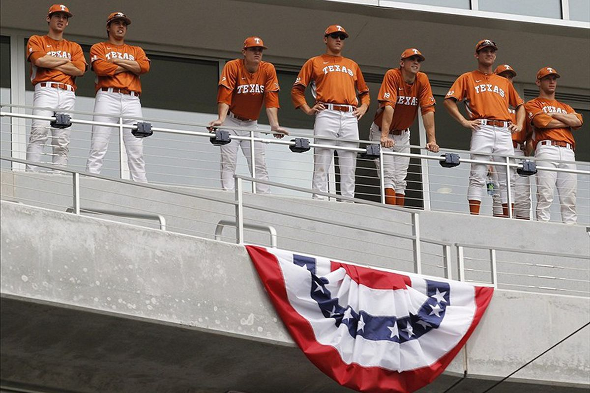 June 17, 2011; Omaha, NE, USA; Texas Longhorns baseball players watch the Florida Gators practice during the opening day of the College World Series at TD Ameritrade Park. Mandatory Credit: Bruce Thorson-US PRESSWIRE 6/17/2011 12:00:00 AM