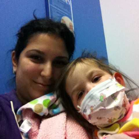 Olivia Donnelly with her mom Lisa Donnelly after the girl's first heart transplant seven years ago.