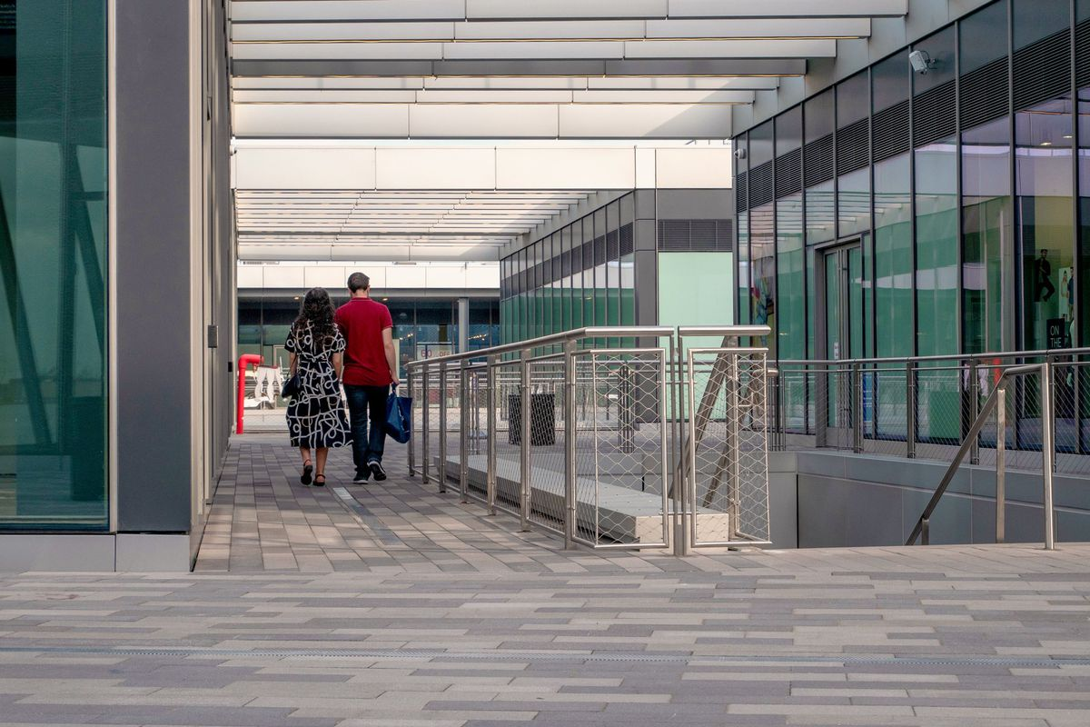 At Empire Outlets a couple walks through a near empty level