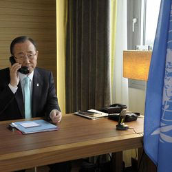 In this photo provided by the United Nations, United Nations Secretary-General Ban Ki-moon speaks via telephone to with U.N.-Arab League envoy Kofi Annan from his hotel room in Geneva, Switzerland on Thursday, April 12, 2012, the deadline for the cease-fire in Syria. Syria's opposition called for widespread protests Friday to test the regime's commitment to an internationally brokered cease-fire that the U.N. chief described as so fragile it could collapse with a single gunshot.