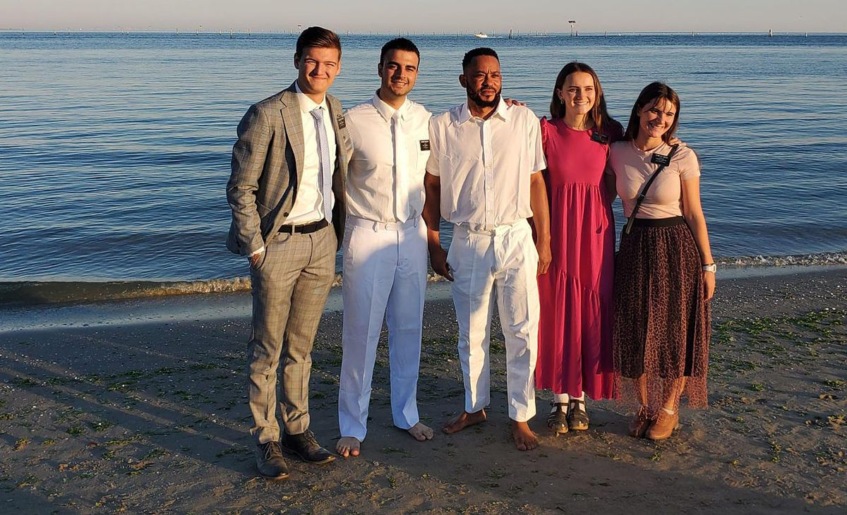 Elders Cole Draper and Samuel Nagliati and Sisters Ellie Giboin and Bailey Randle pose with Lucky Ughulu near the Adriatic Sea prior to his baptism in Italy on Sunday, Sept. 12, 2021.