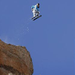 Suzanne Graham, of Salt Lake City, flies off a ski ramp at the top of 600-foot-cliffs before opening her chute in Echo Canyon. She is the world's only active female ski BASE jumper.