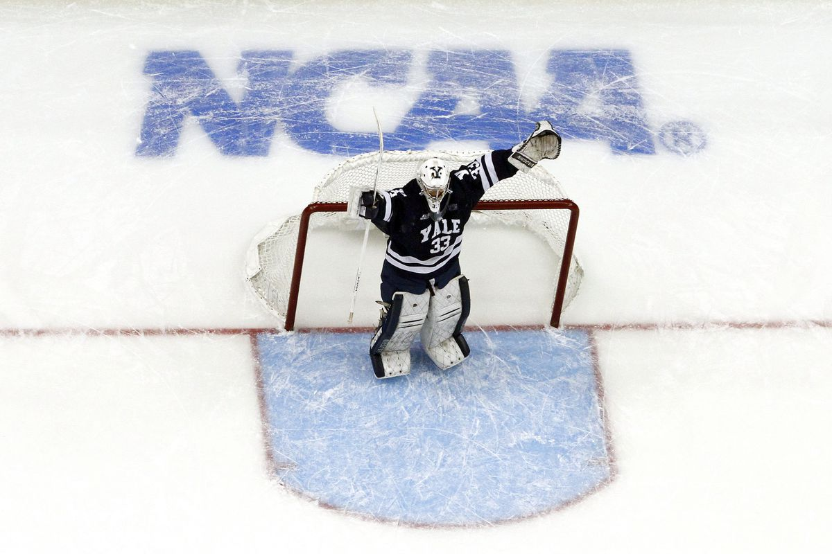 Yale goaltender Jeff Malcolm celebrates his team winning the NCAA Championship at the 2013 Frozen Four in Pittsburgh, Pa.