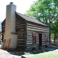 This Is the Place Heritage Park's village is home to structures of all sorts, from stately pioneer residences to Indian lodges and plain cabins like John and Harriet Dyer Gardiner's, built in 1864 in Pleasant Grove and moved to its present location in 1979.