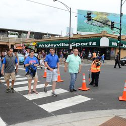 5:29 p.m. Sheffield Avenue being closed off to traffic, at Addison -