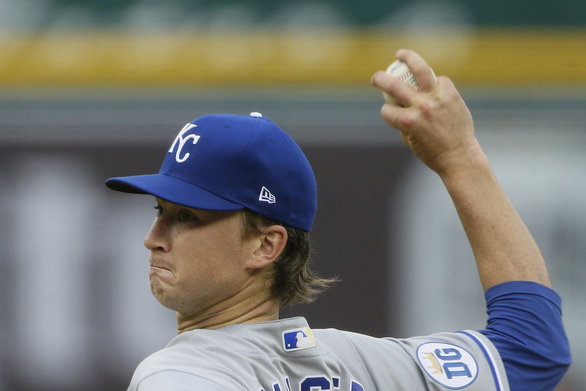 Brady Singer throwing a pitch