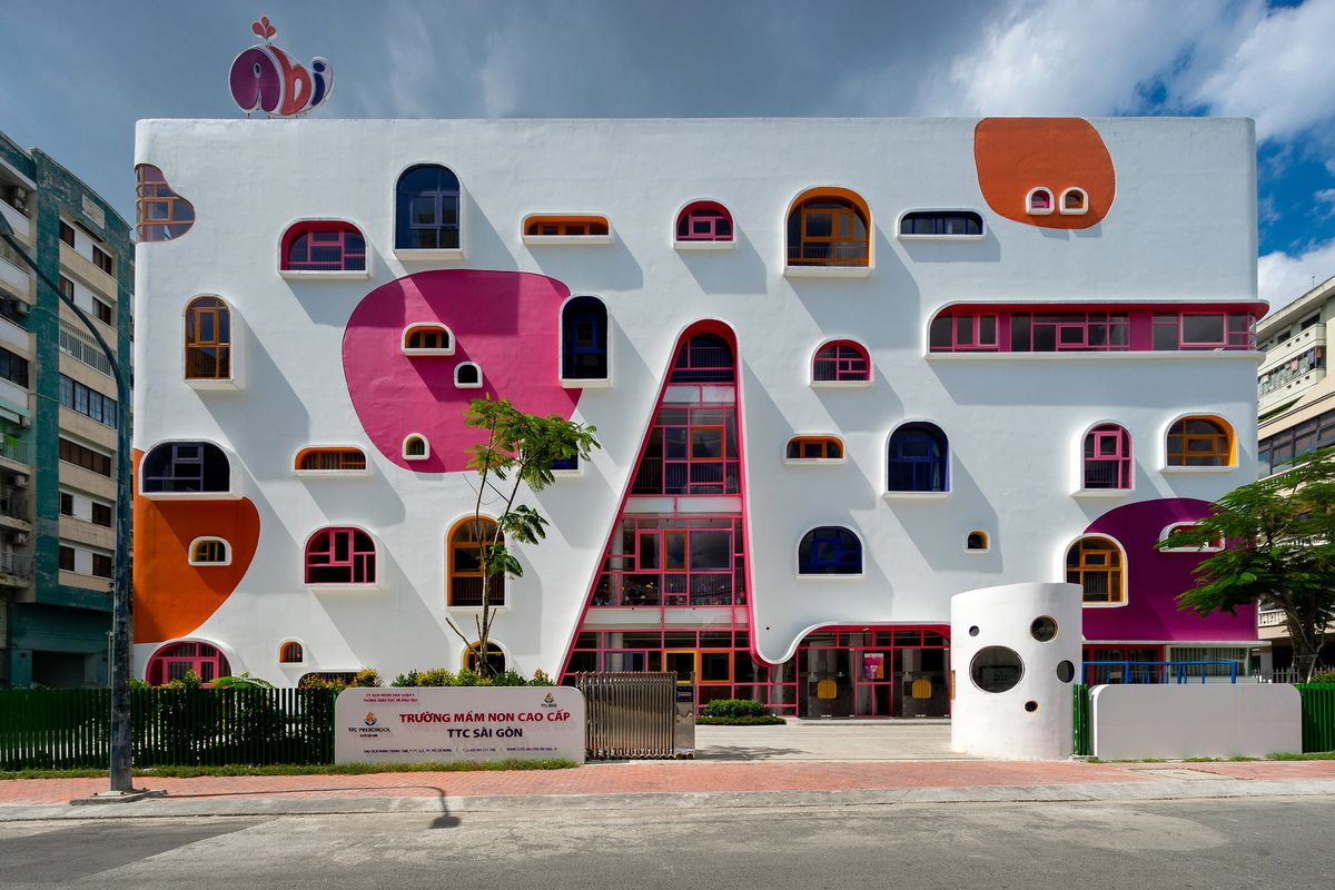 White building with colorful window frames